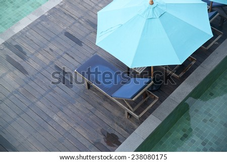 deck-chairs with umbrella  - stock photo
