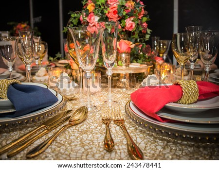 decorated  table with plates and serviettes - stock photo