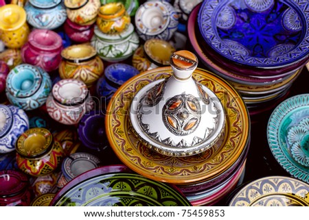 decorated tagine and traditional morocco souvenirs in medina souk - stock photo