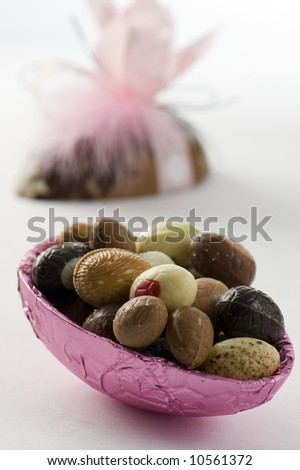 decorative easter egg.  Small eggs inside. Isolated on white background. - stock photo