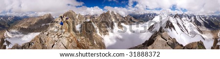 360 degree panorama of the Caucasian mountains from top Kichkidar with climbers at the top, Russia - stock photo