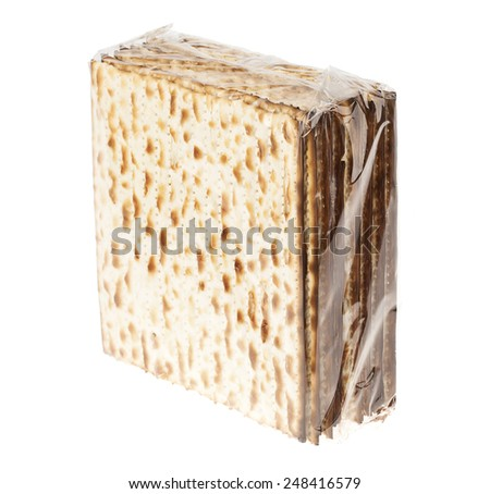 45 degrees diagonal view of a nylon wrapped package of Jewish Matzah bread, the substitute for bread on the Jewish Passover holiday, isolated on white background. - stock photo
