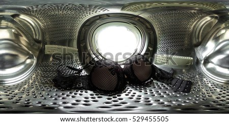 360 degrees spherical panorama view inside a washing machine with lingerie