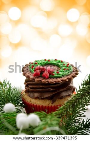 delicious Christmas cupcake with chocolate cream - stock photo