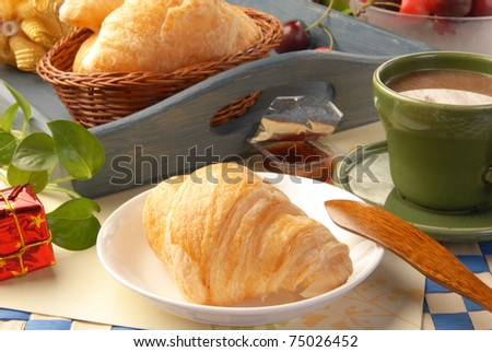 Delicious croissants on white tray