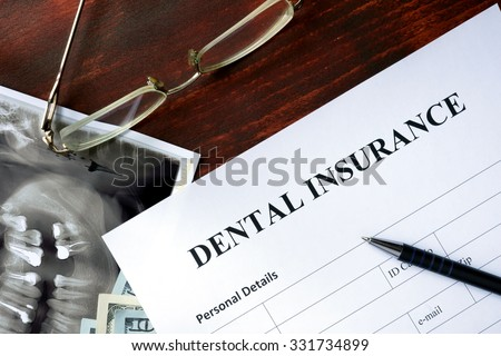 Dental insurance form on the wooden table. - stock photo