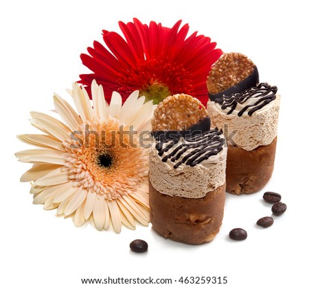Dessert.Cakes and flowers.The image on a white background.
