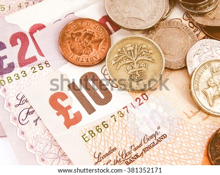 Detail of British Pounds banknotes and coins vintage - stock photo