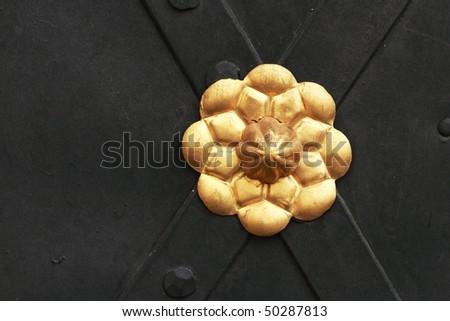 detail of metal door decoration - stock photo
