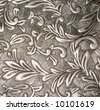detail shot of carved metal design for background texture - stock photo