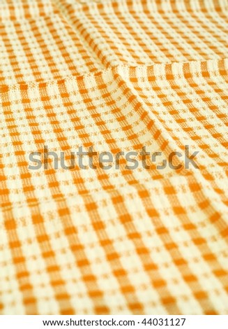 Detailed yellow picnic cloth - stock photo