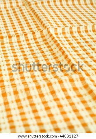 Detailed yellow picnic cloth - stock photo
