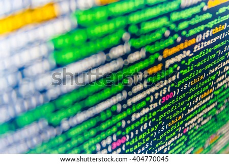Developer working on software codes in office. Writing program code on computer.  Source code photo. Website programming code. Abstract screen of software.   - stock photo