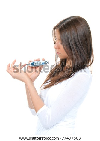 Diabetes patient woman measuring glucose level blood test using ultra mini glucometer and small drop of blood from finger and test strips isolated on a white background - stock photo
