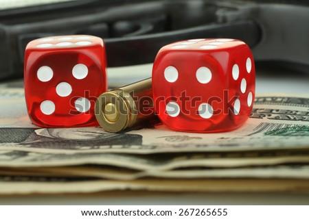 dice, gun and money - stock photo