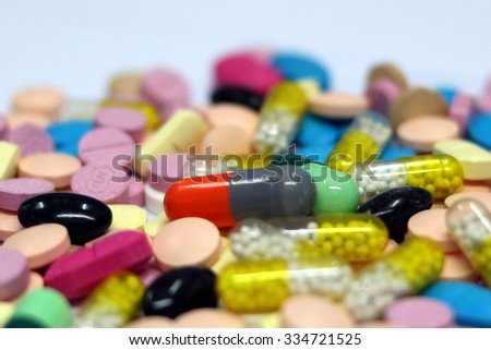 diferent Tablets mix heap drugs pills capsules therapy doctor flu antibiotic pharmacy medicine medical - stock photo
