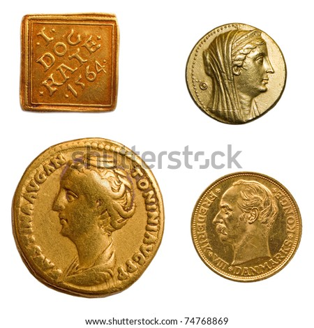 4 different genuine antique gold coins. - stock photo