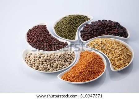 different legumes - lentils, beans and peas - stock photo