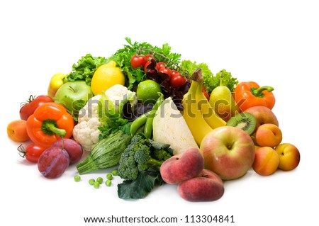 Different sorts of vegetables, fruit and spicy herbs - stock photo