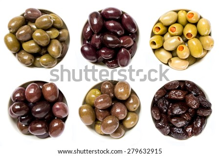6 different types of olives in white cups on white background. 2 rows of 3 cups. Olives green, black, and green with pepper. The variety of olives. Horizontal frame. Top view. Clouse-up.  - stock photo