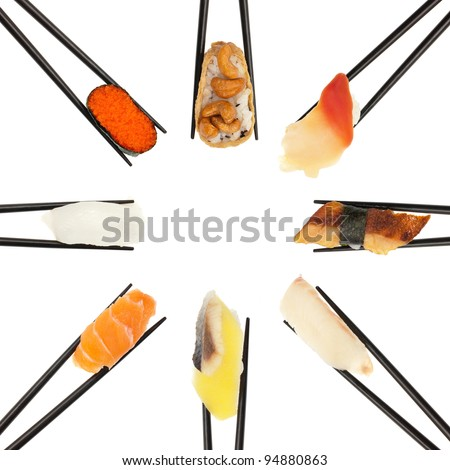 8 different types of sushi being held up in in a circle formation with black chopsticks isolated on white. - stock photo