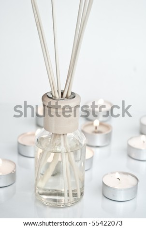 Diffuser with sticks and candles - stock photo