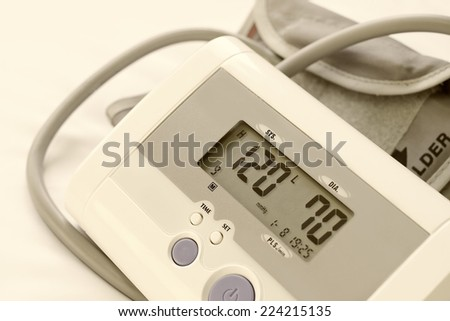 Digital blood pressure monitor ( sphygmomanometer ),show normal blood pressure - stock photo