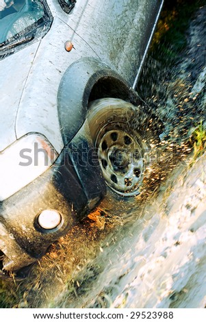 Dirty wheel of  cross-country vehicle - stock photo