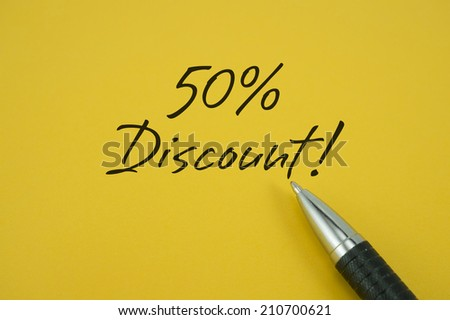 50% Discount! note with pen on yellow background - stock photo