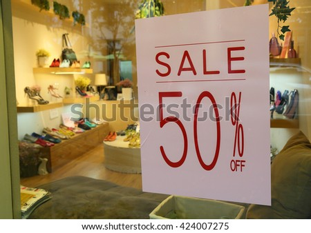 50% discount sale sign on store window