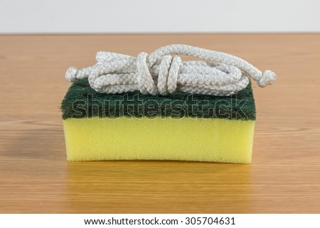 dish washing sponge on white background with clipping path - stock photo