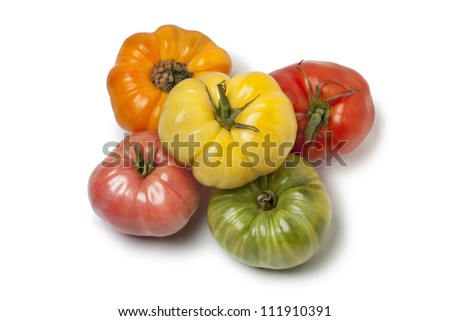 Diversity of whole  Beefsteak Tomatoes on white background