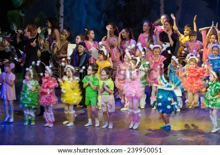 DNIPROPETROVSK, UKRAINE - DECEMBER 25: Unidentified children, ages 4-13 years old, perform PUSHISTIKI at the State Palace of children and youth on December 25, 2014 in Dnipropetrovsk, Ukraine - stock photo