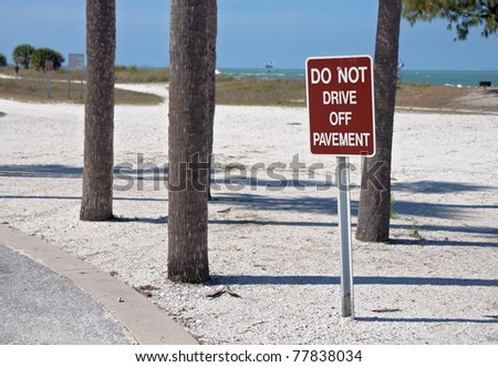"""Do Not Drive Off Pavement"" sign, near the beach."