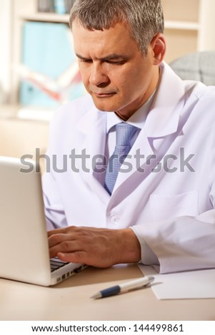 doctor in his office with the computer - stock photo