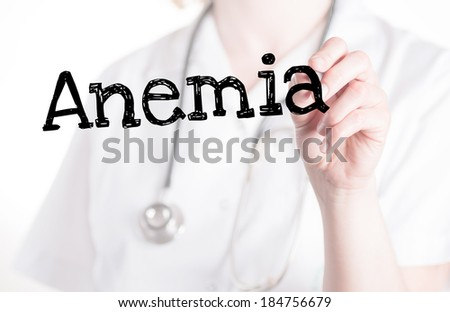 Doctor shows information on glass: anemia - stock photo