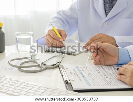 2 doctors working in office of hospital. - stock photo