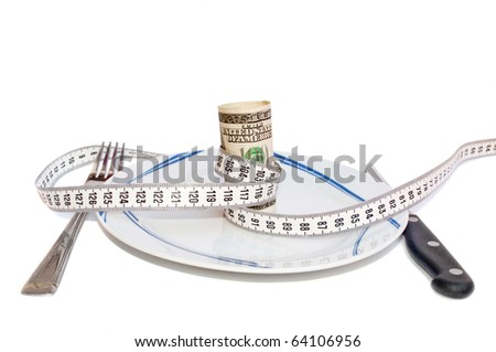 100 dollar banknote wrapped with centimeter on the plate - stock photo