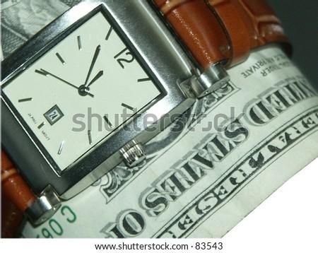 1 dollar bill and wrist watch - stock photo
