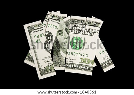 100 dollar bill in pieces