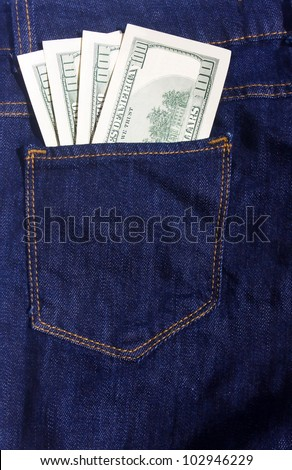 100-dollar bills in the pocket of blue jeans - stock photo