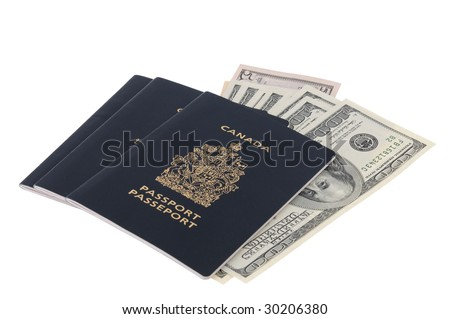 100-dollar bills inserted between pages of Canadian passports - stock photo