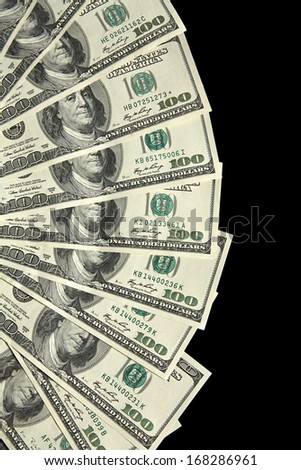100 dollar notes laid out as fan / studio photography of american national currency of hundred dollar isolated on black background  - stock photo