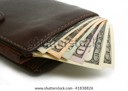 Dollars banknotes in leather brown purse on white background