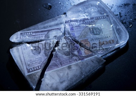 100 Dollars frozen and cracked ice. - stock photo