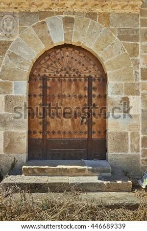 door in semicircular arch - stock photo