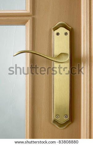 Door knob on the wooden door. Close up - stock photo