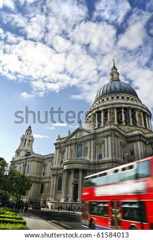 Double decker passing by front of St Paul's Cathedral. Summer sky for copy space. - stock photo