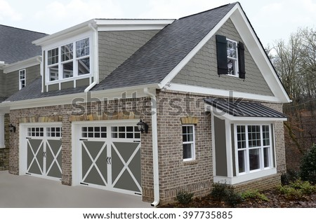 Double door garage on the back of a newly constructed modern house. - stock photo