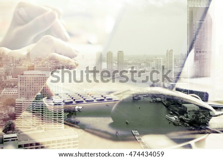 Double exposure image of woman using computer and cityscape background,Computer networking concept.